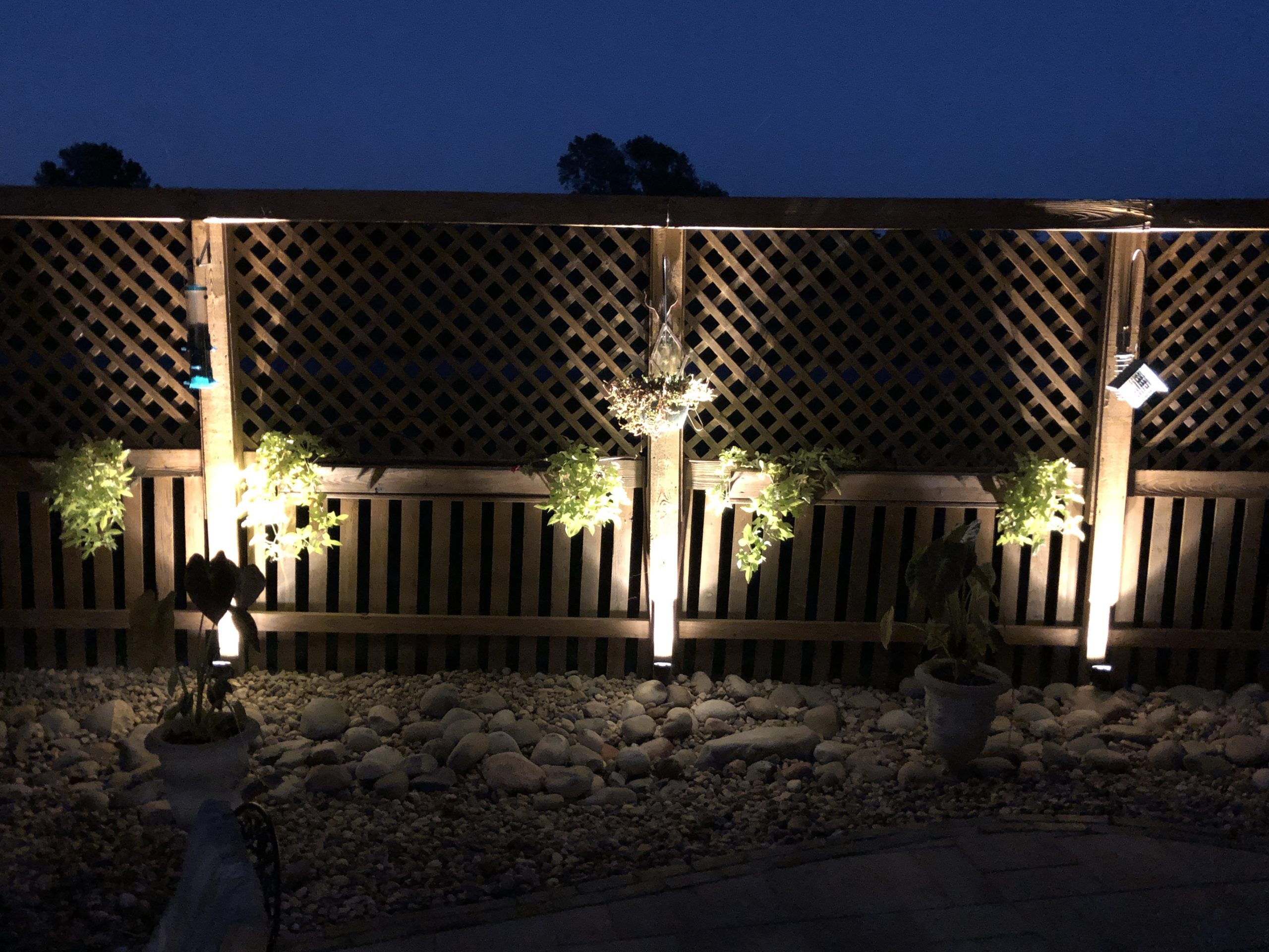 outdoor accent lighting on fence